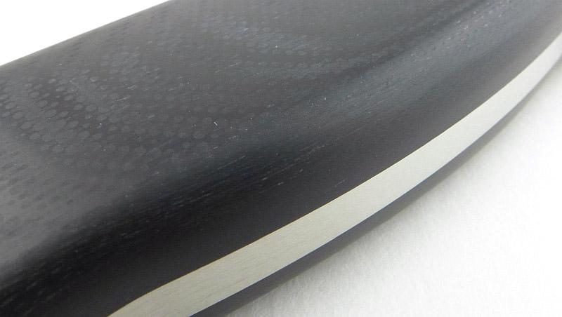 [Image: 31-Spyderco-Bradley-handle-texture-P1290893.jpg]